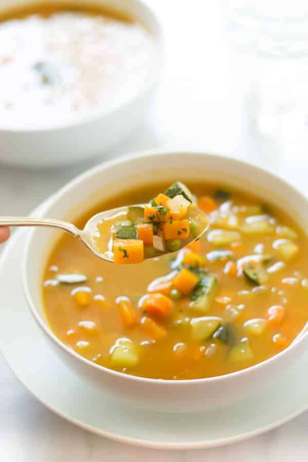 Summer Soup with peas, carrots and zucchini primavera kitchen recipe