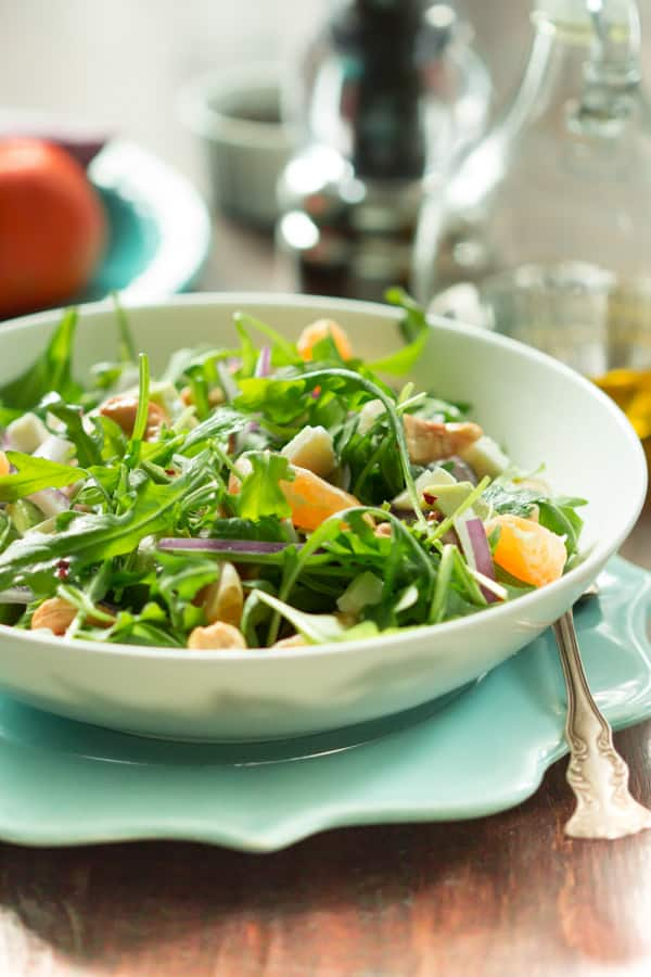 Clementine arugula salad is made epic with homemade clementine dressing. This salad is so bright and fresh, you might even be glad it's winter – clementine's favorite season!