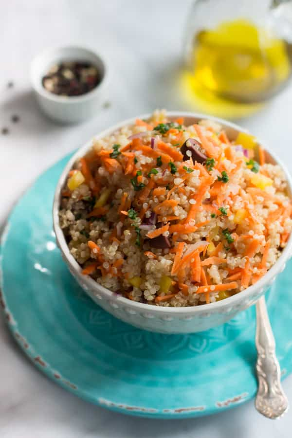 Carrot Quinoa Salad - This quinoa salad is filled with shredded carrots, red onions, bell pepper and olives. It is gluten-free, vegan, healthy and very flavourful too.