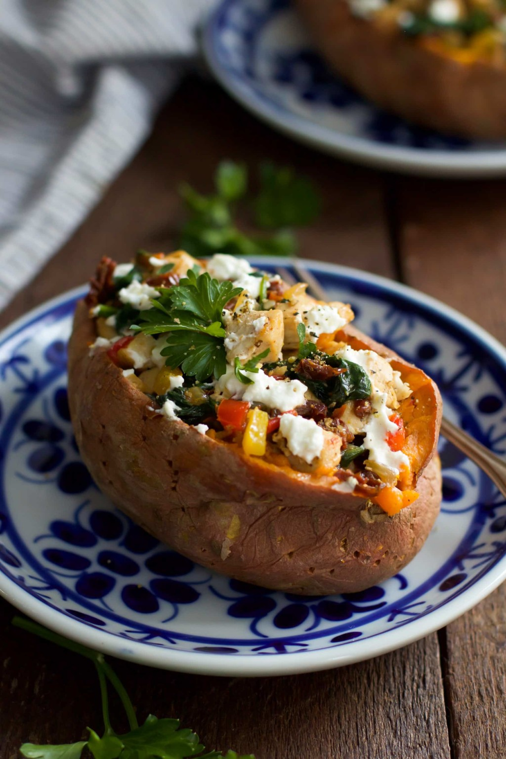 Goat Cheese Chicken Stuffed Sweet Potato_- This ultra-easy to make Goat Cheese Chicken Stuffed Sweet Potato recipe is healthy, filling and delicious. It is made with spinach, chicken, garlic, onions, bell peppers and goat cheese. This is definitely a perfect meal for chilly winter nights that requires simple ingredients.