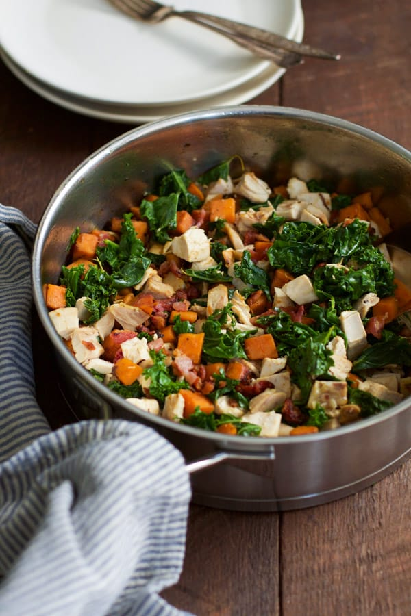 sweet-potato-chicken-kale-skillet_- This Sweet Potato Chicken Kale Skillet recipe is a delicious one-pan meal that will be on your dinner table in less than 30 minutes. It is also gluten-free, paleo friendly and perfect for your busy weeknight dinner.