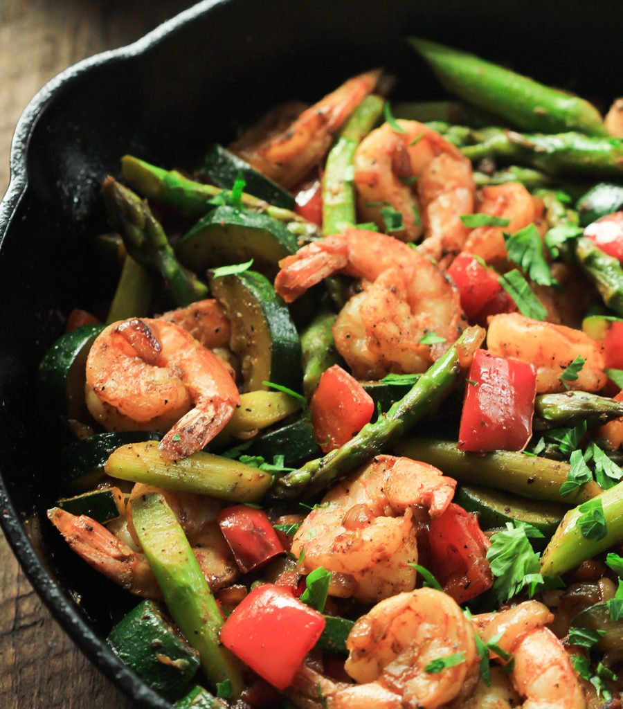 This ultra-easy Shrimp Vegetable Skillet recipe is loaded with veggies, flavorful spices and shrimp. It's a low-carb, gluten-free and paleo one-pan meal that is ready in less than 30 minutes.