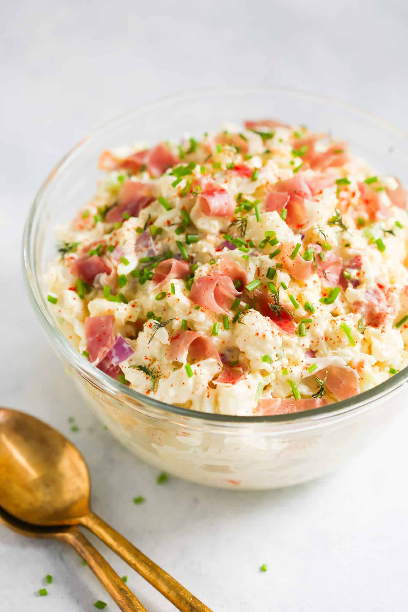 Cauliflower Potato Salad - Love Potato Salad, but hate all the carbs and calories that come with it? How about trying this Cauliflower Potato Salad? It has all the flavors of the traditional potato salad, but it has no potato and it's healthier!