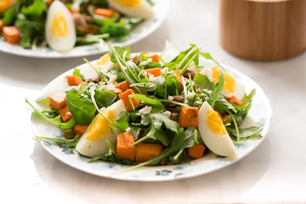 sweet-potato-arugula-salad - This Sweet Potato Arugula Salad is packed with pistachios, sweet potato, feta cheese and a delicious honey Dijon vinaigrette that pairs deliciously with arugula.