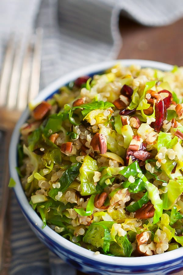 warm-quinoa-brussels-sprouts-salad-This Warm Quinoa Brussels Sprouts Salad is made with sauteé brussels sprouts, dried cranberries, chopped pecans and it's tossed with a delicious orange vinaigrette.