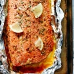 wild salmon fillet with lemon slices and garlic butter