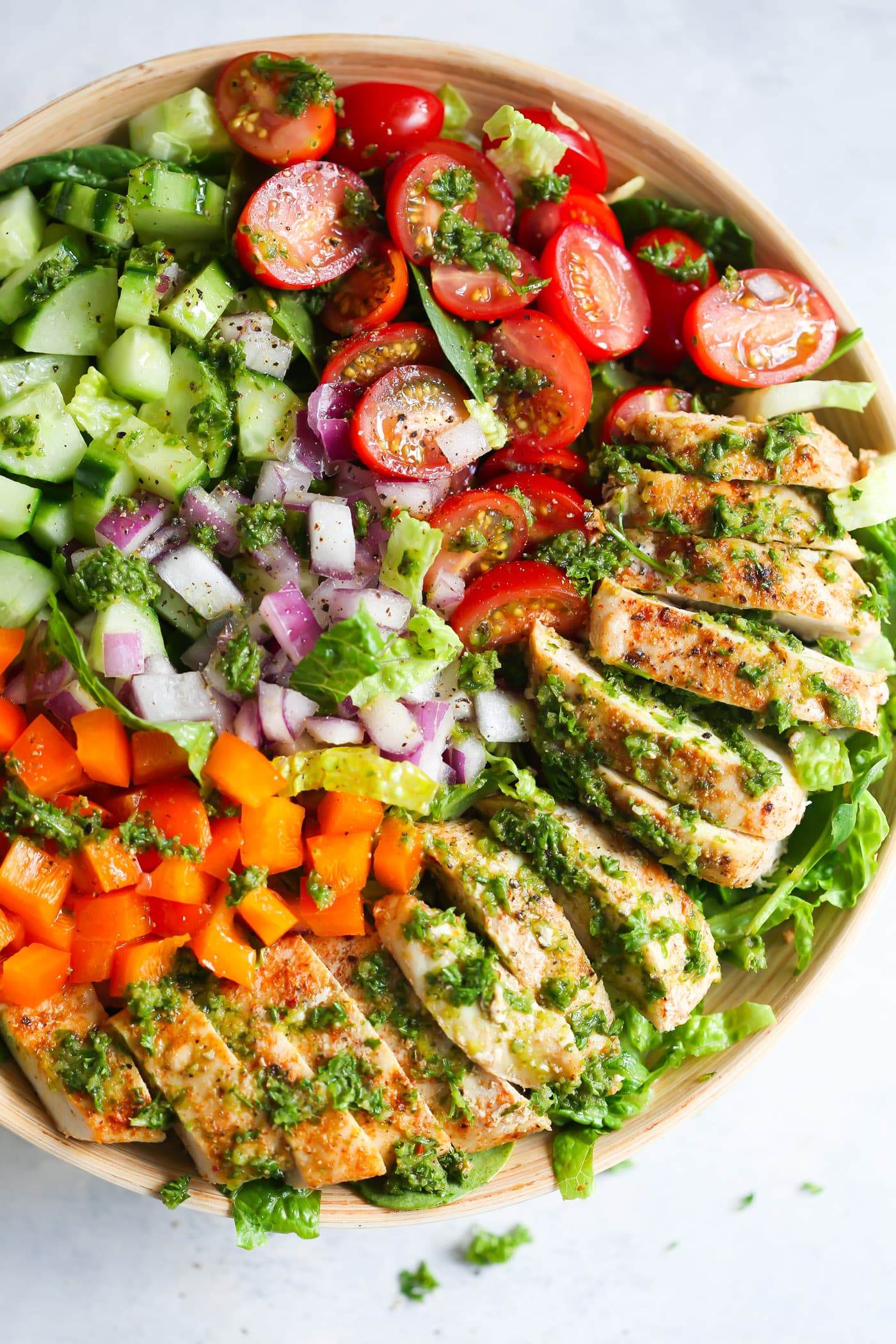 This fresh Chimichurri Chicken Chopped Salad is loaded with lettuces, cherry tomatoes, cucumber, bell pepper, red onions and grilled chicken. It's a complete meal to enjoy this summer!