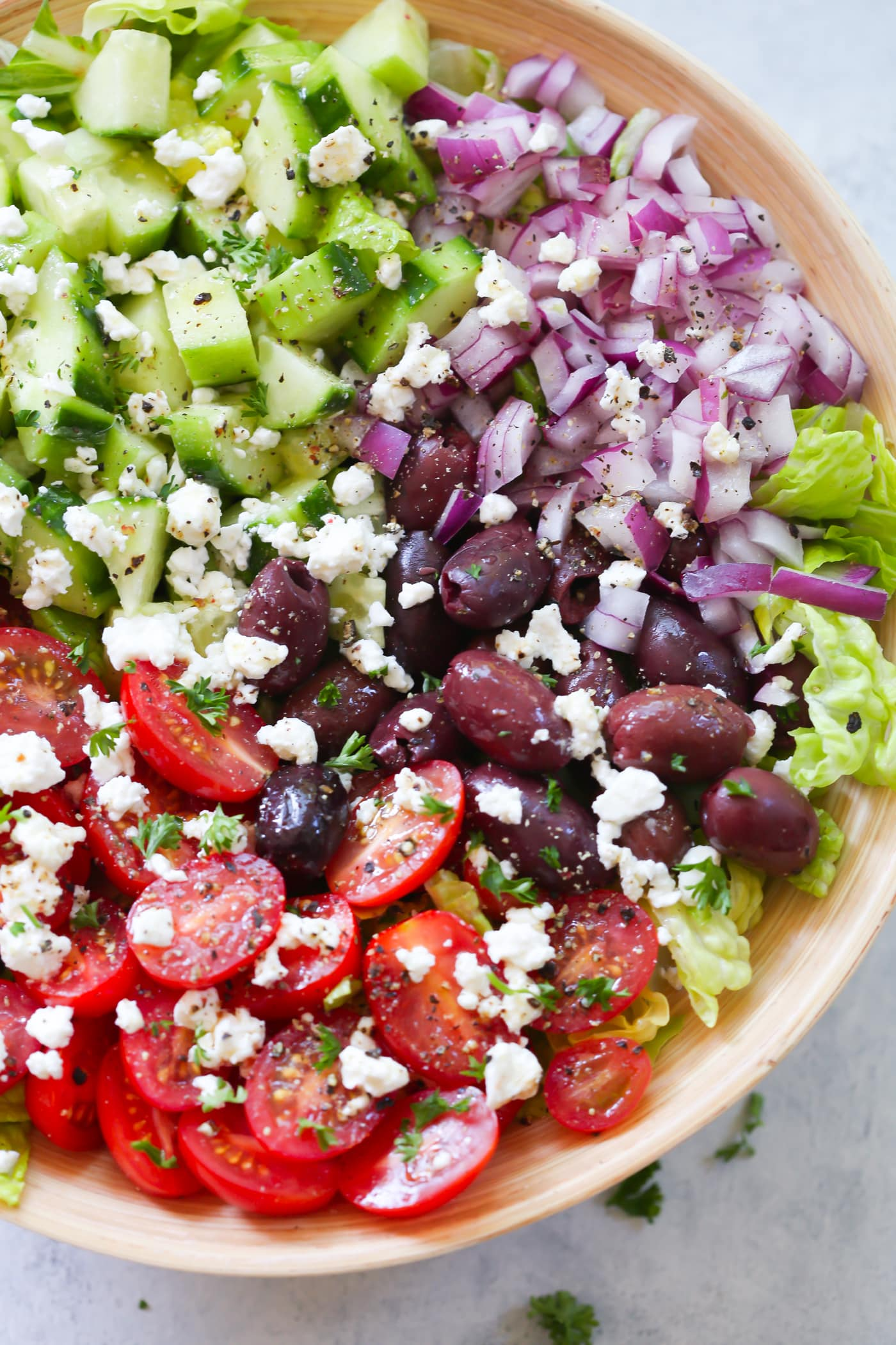 Easy Mediterranean Chopped Salad - Enjoy this Easy Mediterranean Chopped Salad made with red onions, black olives, lettuces, cucumber, cherry tomatoes, feta cheese and light lemon dressing!