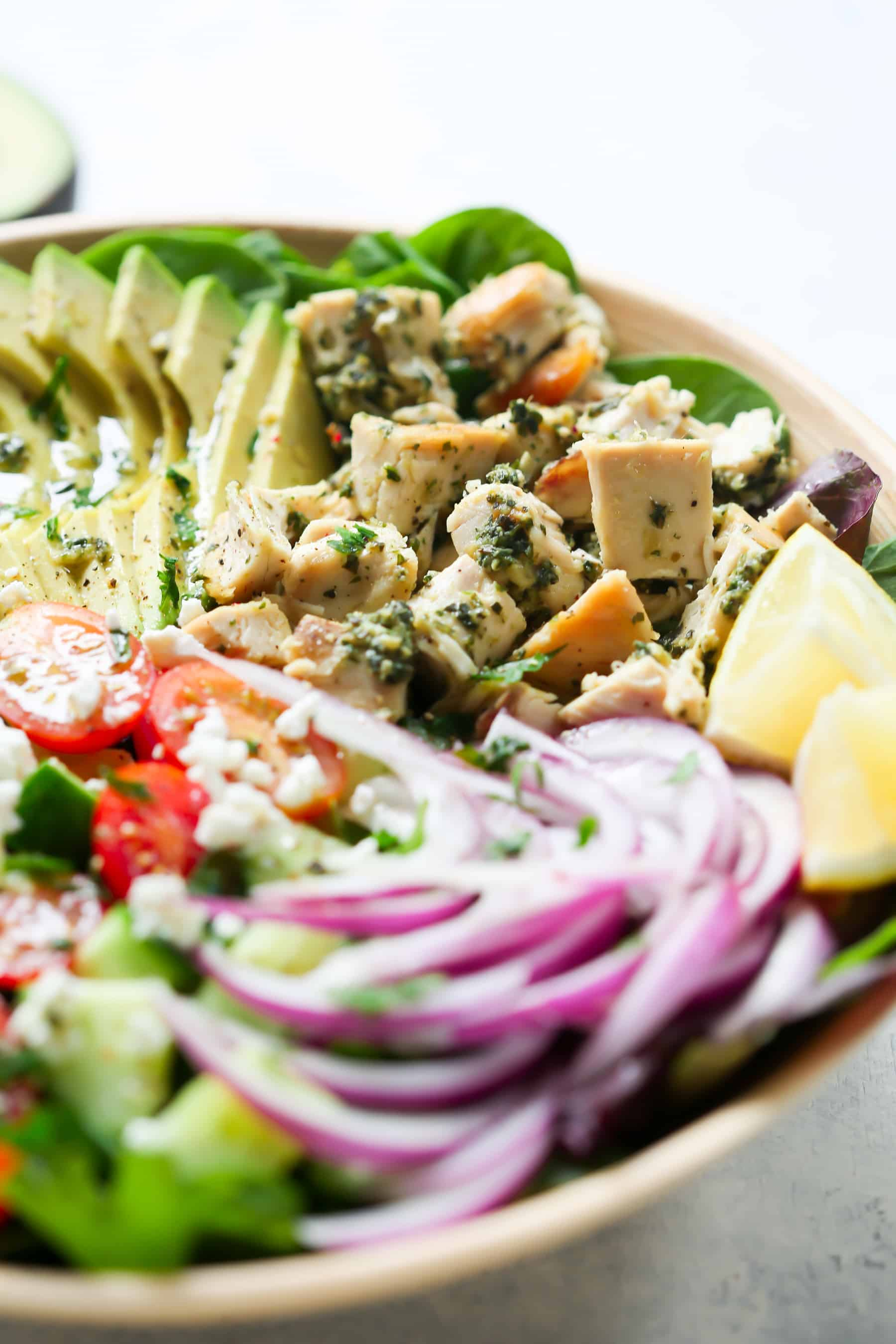 Pesto Chicken Salad - This healthy, easy, filling and super delicious Pesto Chicken Salad recipe is loaded with lettuces, cherry tomatoes, avocado, red onions and flavoured with a light lemon dressing.