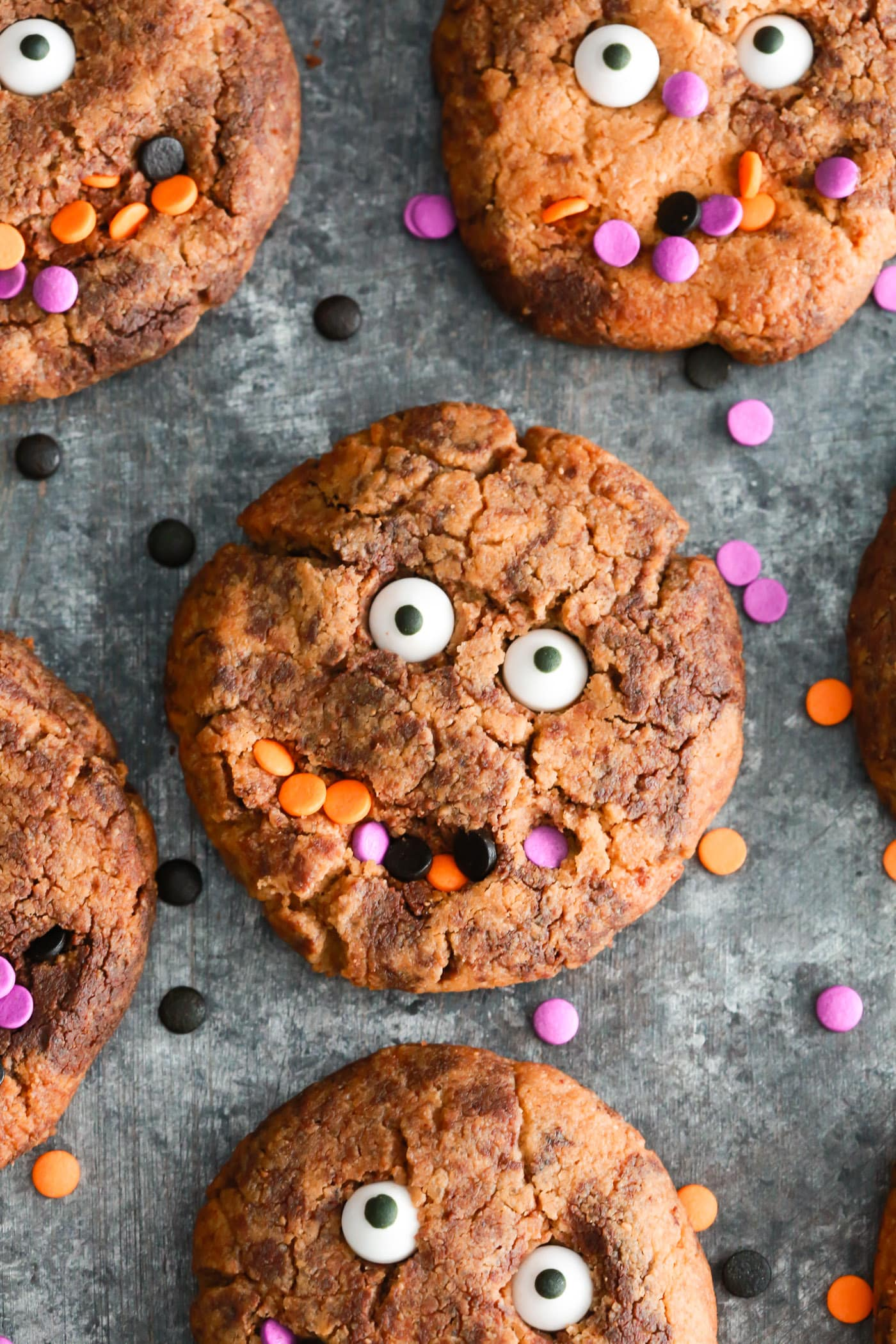 Perfect fun Gluten-free Halloween cookies to make with your kids. They're made with almond butter, natural sweetener and dark chocolate chips.