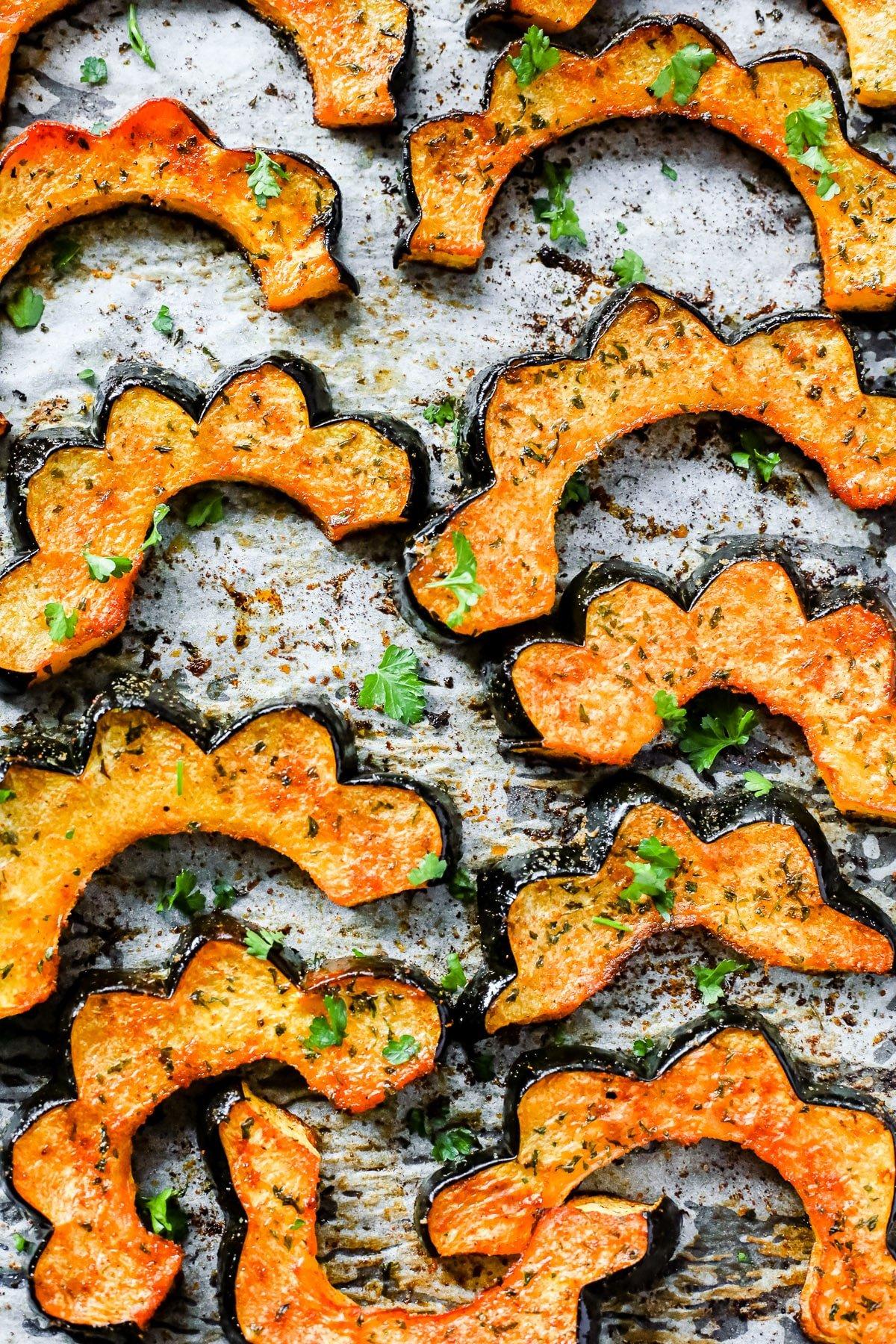 close up - Easy Roasted Acorn Squash on a baking sheet