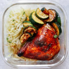 Spicy Chicken with Sauteed Cabbage and Zucchini in glass meal prep container