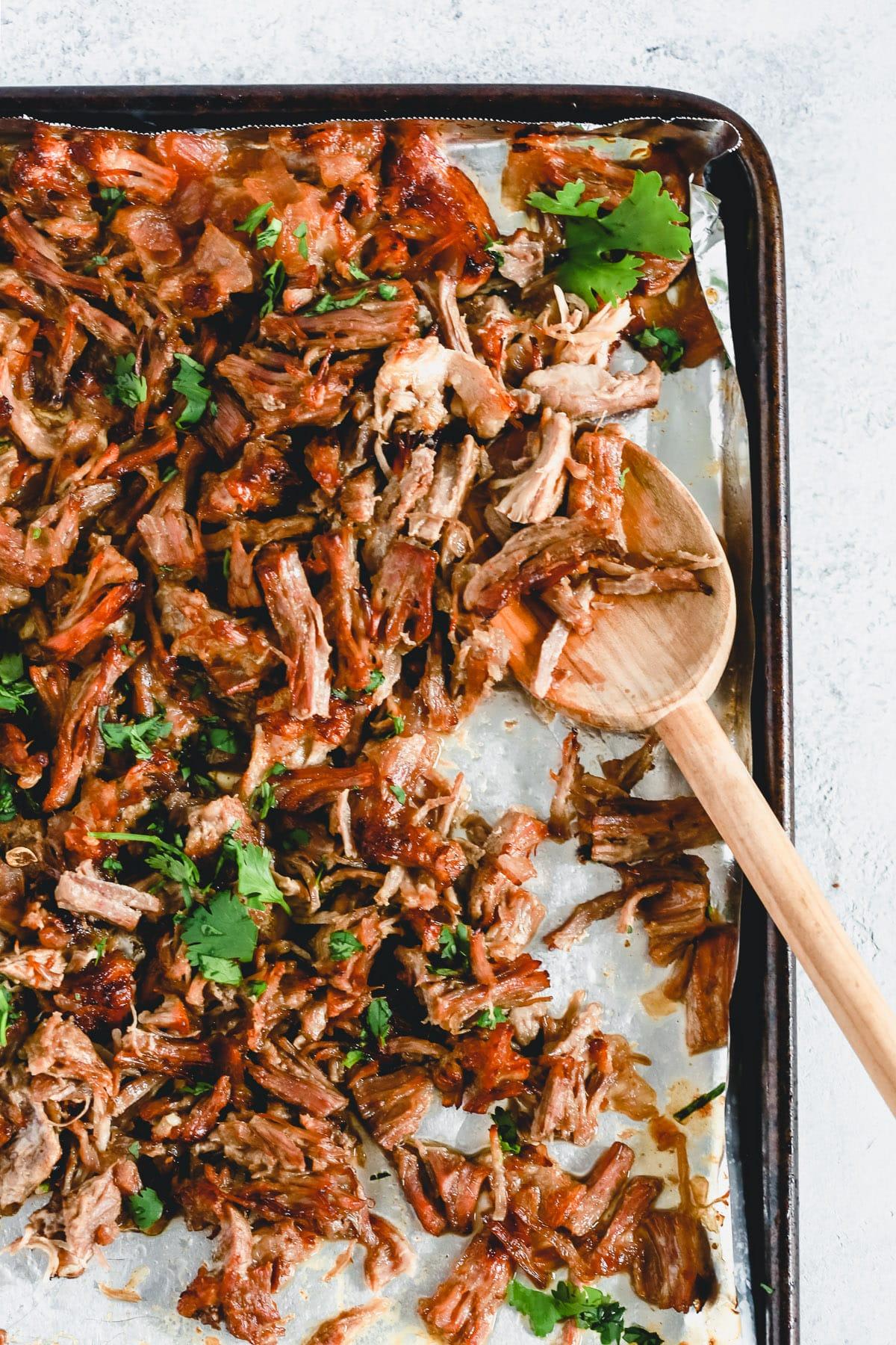 shredded pork carnitas on sheet pan