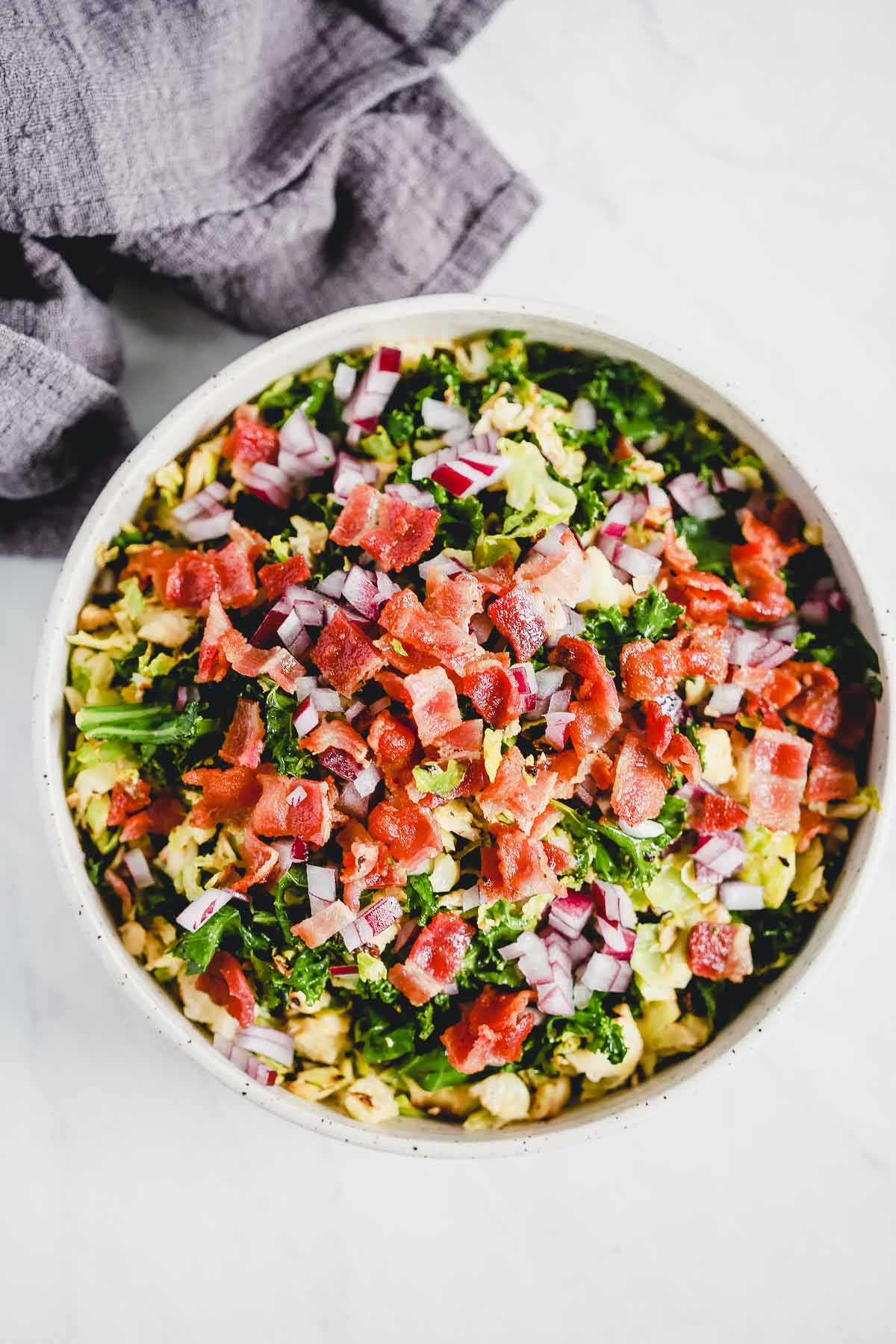 a large bowl with Brussels Sprouts Bacon Salad