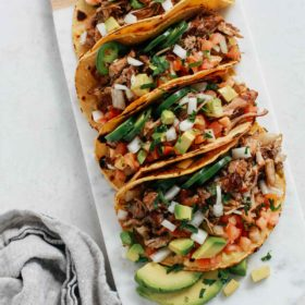 tray of slow cooker carnitas tacos