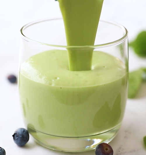 close up of a glass of green smoothie