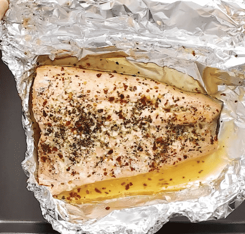 overhead view of cooked salmon in a foil