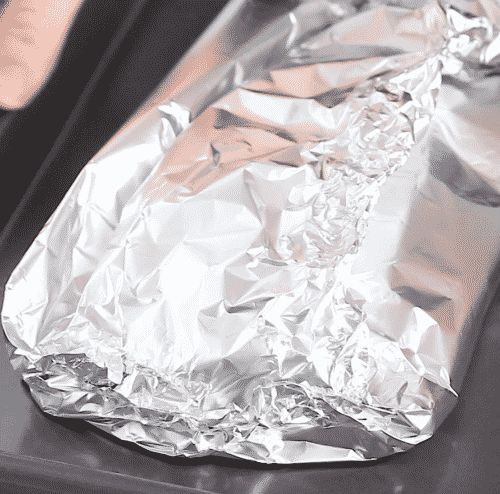 close up view of salmon folded in foil